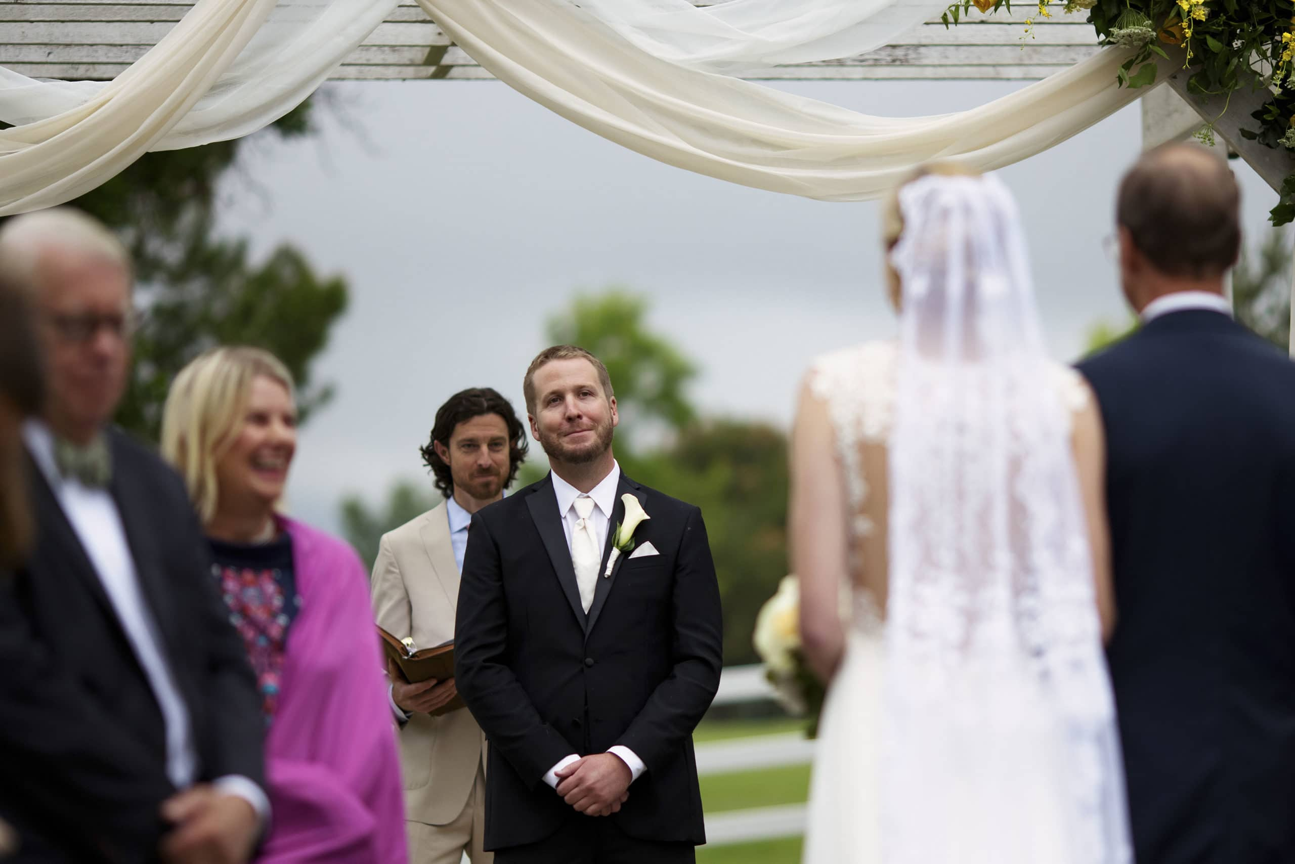 The groom sees the bride as she walks down the aisle