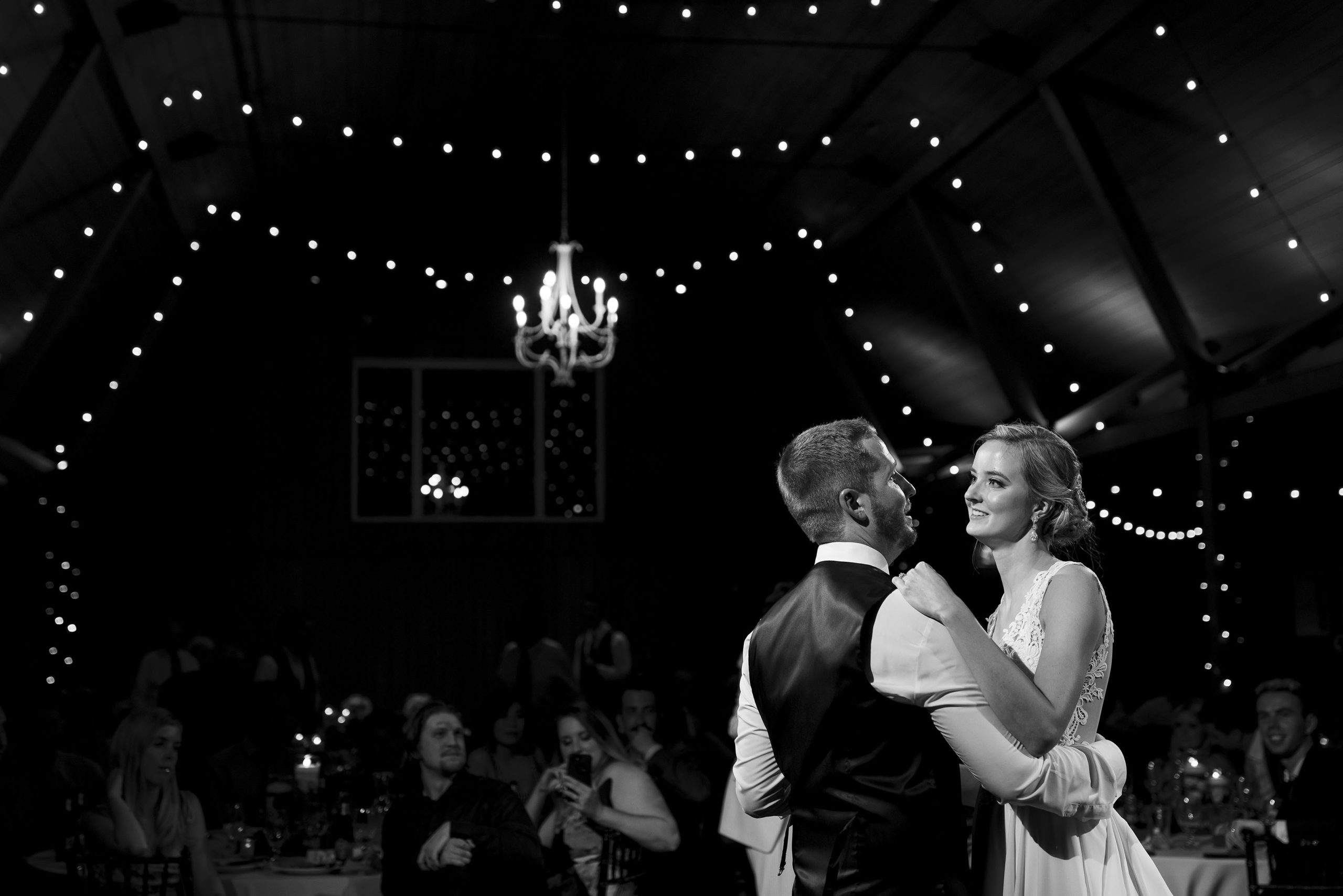 Jennifer and Stefan enjoy their first dance during the wedding reception at the barn at raccoon creek