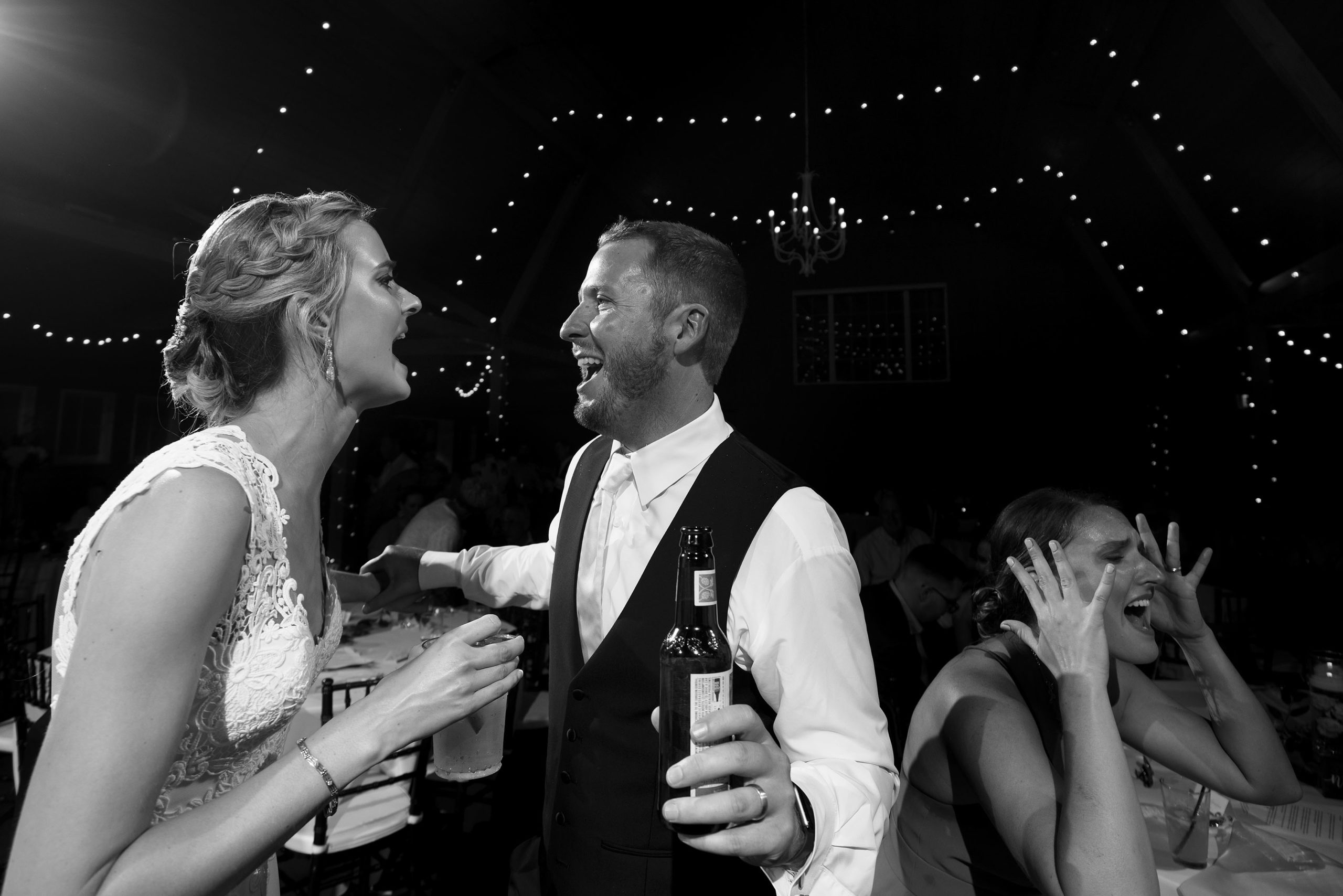 guests dance during a wedding reception at the barn at raccoon creek
