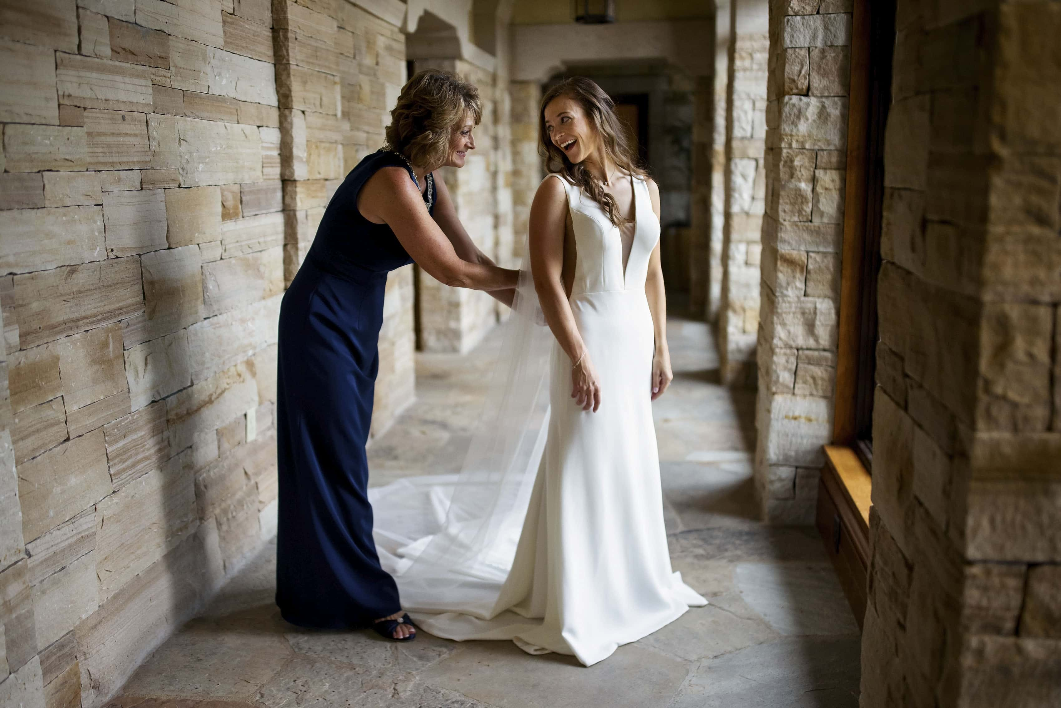 Casey puts on her wedding dress at Sanctuary Golf Course