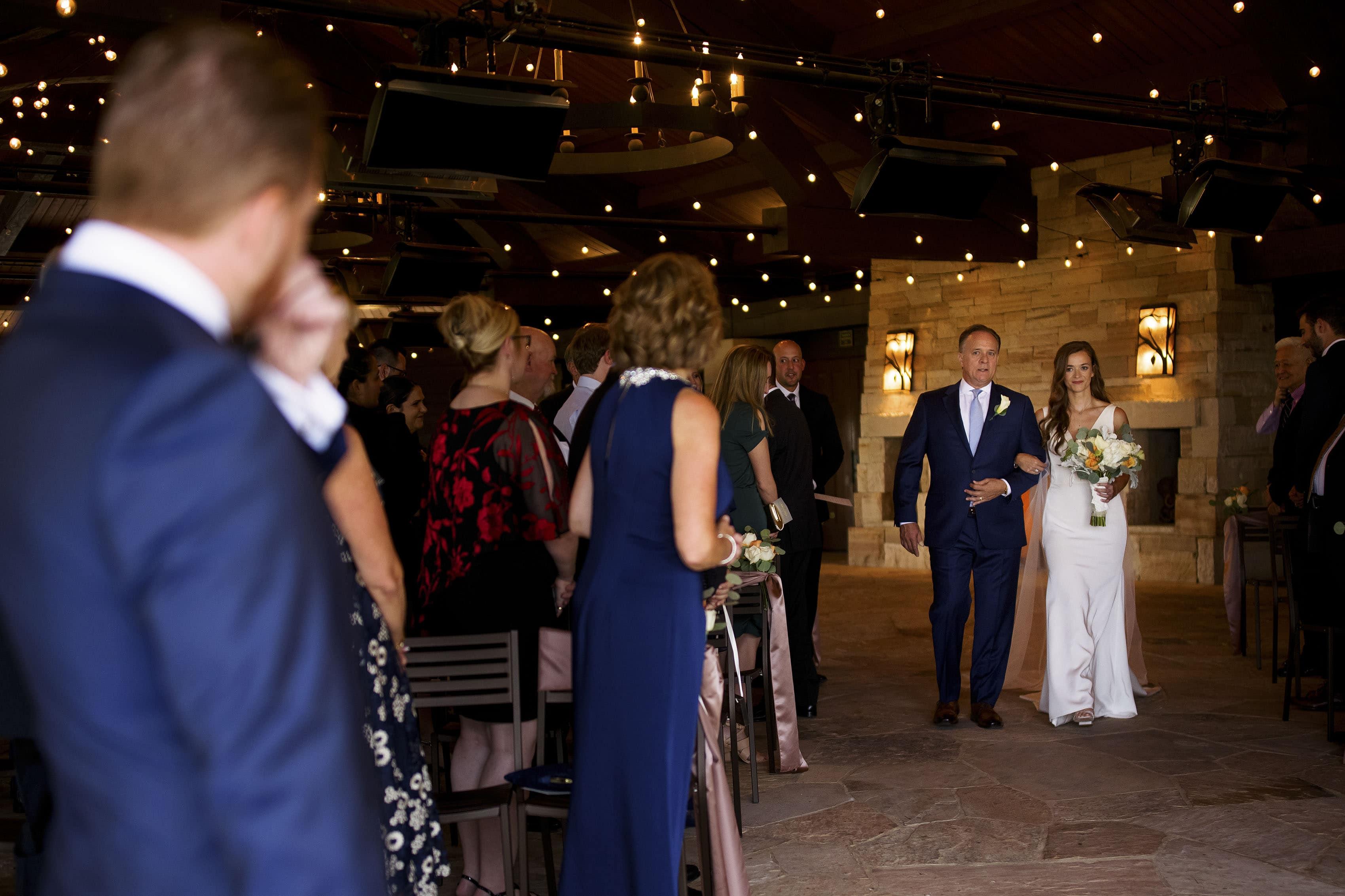 The bride walks down the aisle at Sanctuary Golf Course