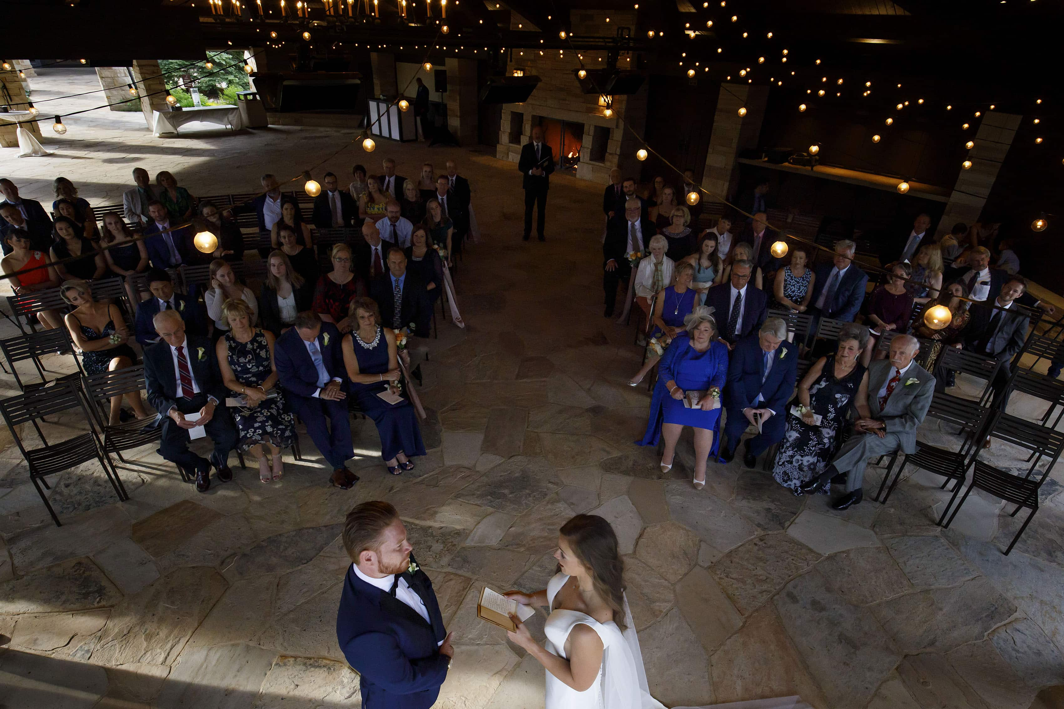 Casey reads her vows to Darren during their ceremony in the pavilion at the Sanctuary