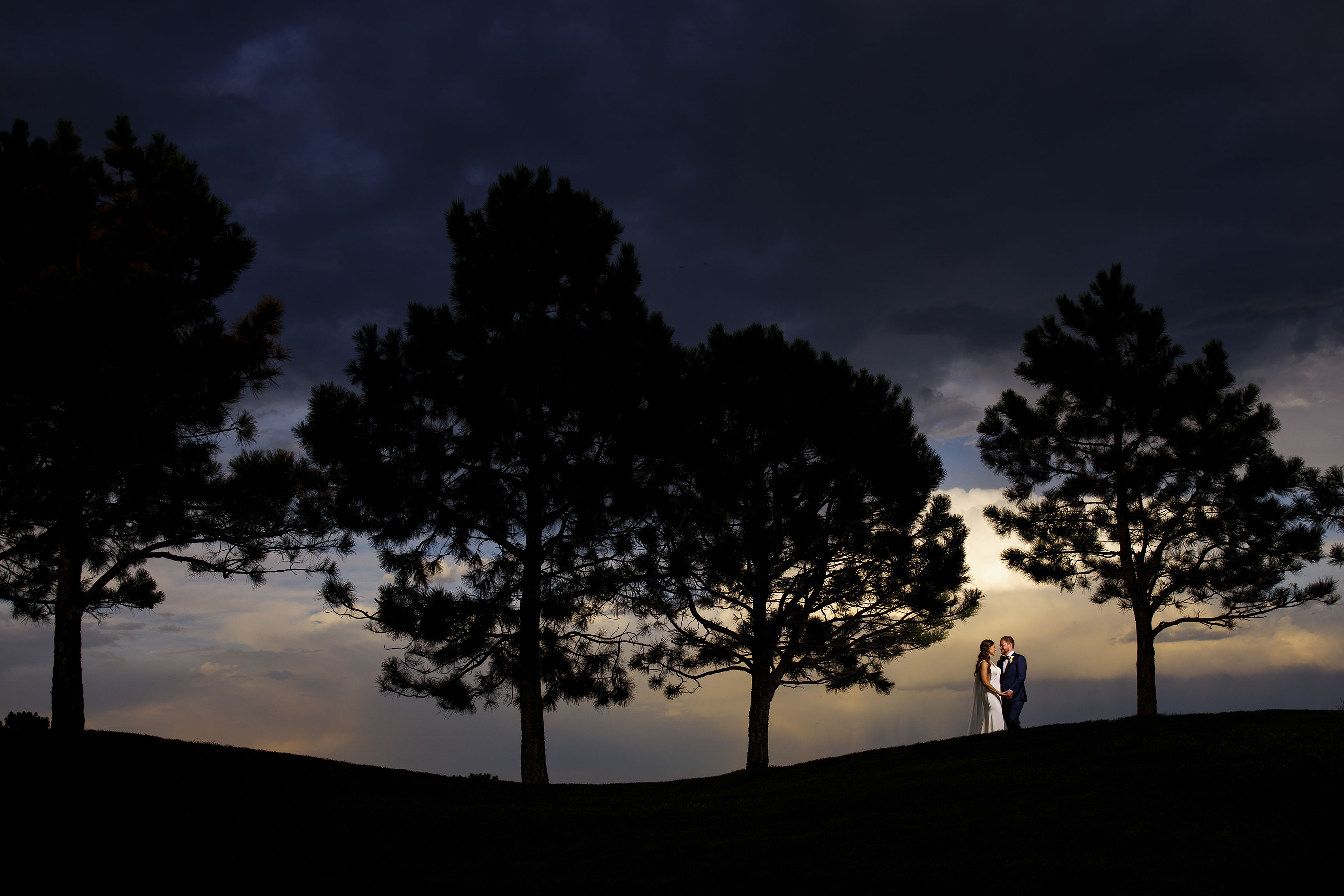 The newlyweds pose during sunset at Sanctuary Golf Course
