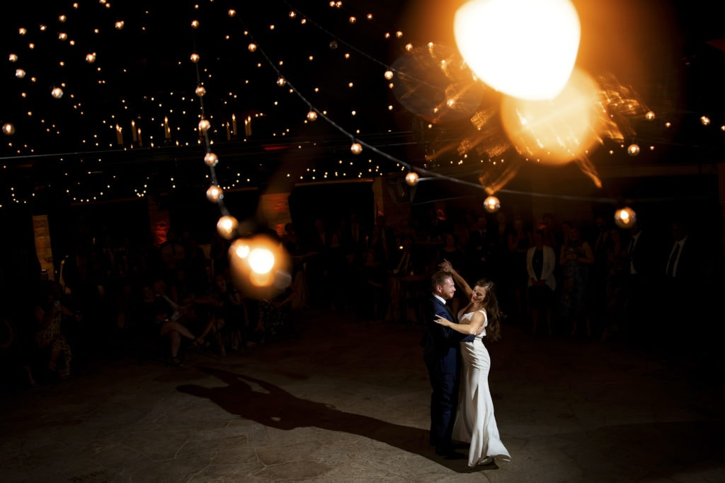 Darren and Casey share their first dance as newlyweds under the market lights in the Sanctuary pavillion