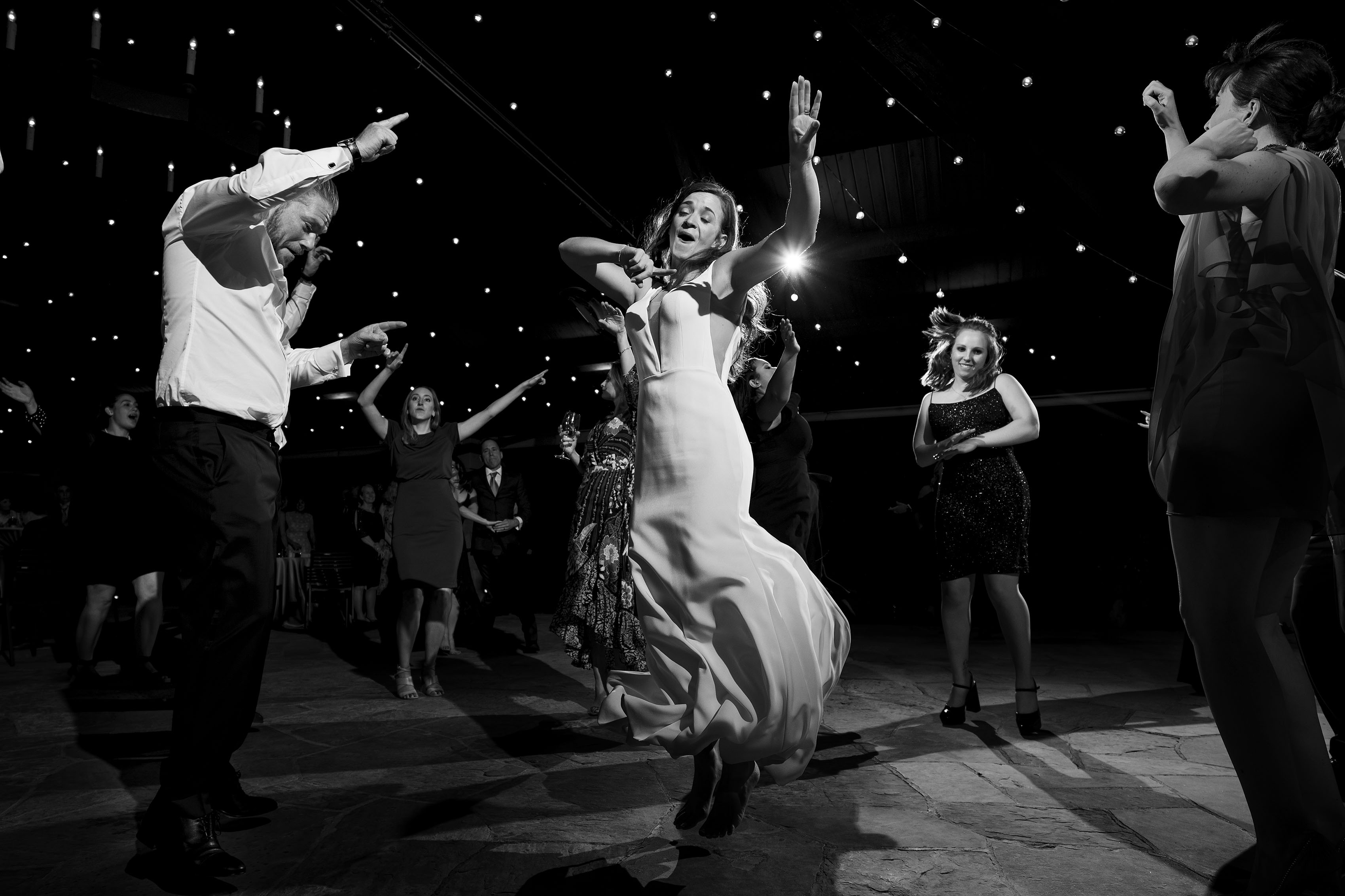 The bride, groom and guests dance during a wedding reception at Sanctuary