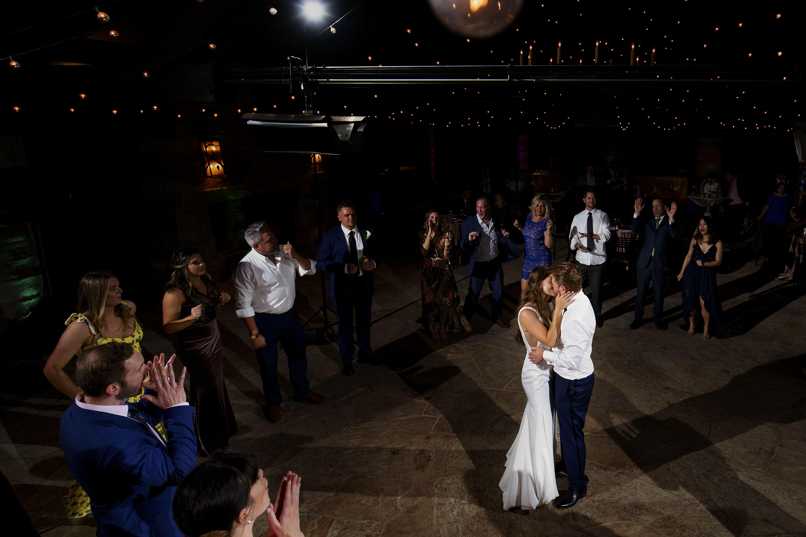 The couple share a kiss on the dance floor during their wedding at Sanctuary Golf Course